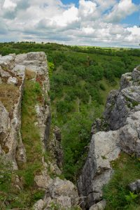 Cheddar Gorge from the top at beautiful weather with a wide view into the landscape
